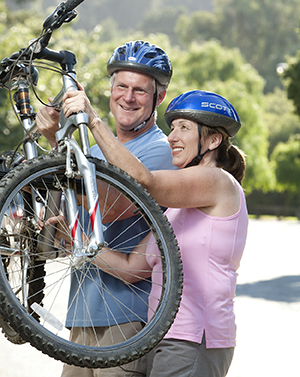 Adult couple riding bicycles.